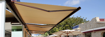 Commercial retractable awnings for shops, restaurants and outside dining